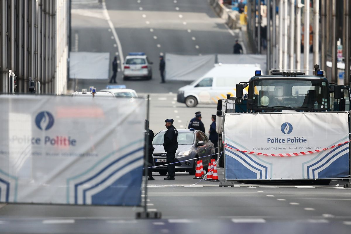 Police officers patrol outside Maelbeek metro station following todays attack on March 22, 2016, in Brussels, Belgium.