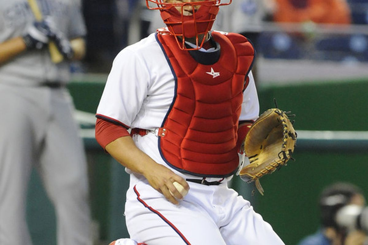 May 14, 2012; Washington, DC, USA; Washington Nationals catcher Sandy Leon (41) looks to the dugout during the game against the San Diego Padres at Nationals Park. Mandatory Credit: Brad Mills-US PRESSWIRE