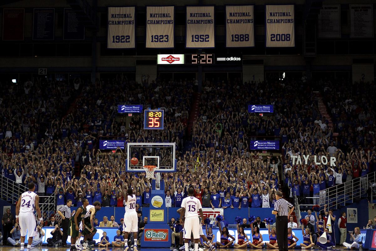 LAWRENCE, KS - DECEMBER 03:  Tyshawn Taylor #10 of the Kansas Jayhawks shoots a free throw during the game against the South Florida Bulls on December 3, 2011 at Allen Fieldhouse in Lawrence, Kansas.  (Photo by Jamie Squire/Getty Images)