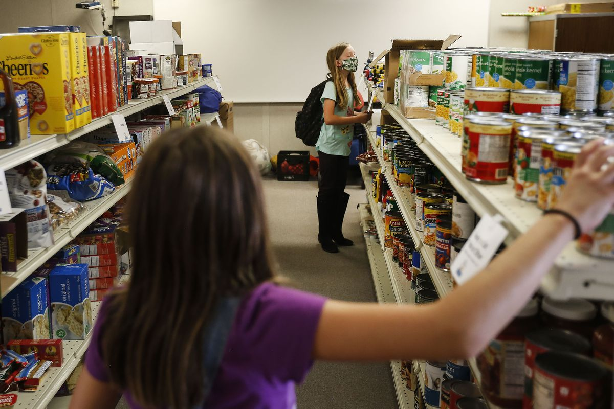 Fifth grader Aubrey Reichert checks out the items in the Mill Creek Elementary Food Pantry & Resource Center during its grand opening at the Millcreek school on Thursday, Sept. 17 2020.