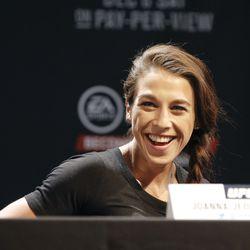 Joanna Jedrzejczyk laughs during presser.