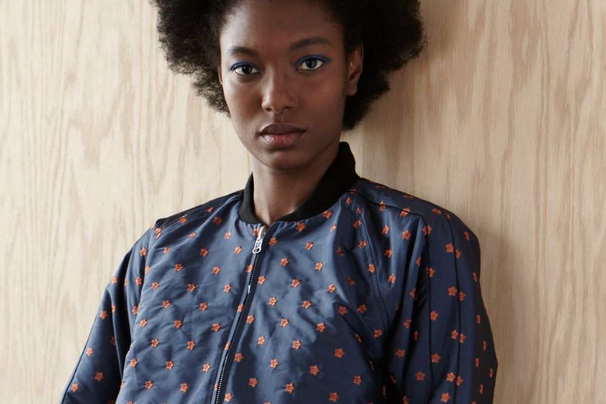 A model wears an embroidered bomber jacket