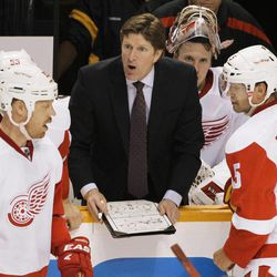 Detroit Red Wings head coach Mike Babcock, center, talks with players, including Johan Franzen (93), of Sweden, and Nicklas Lidstrom (5), also of Sweden, in the third period against the Nashville Predators in Game 1 of a first-round NHL hockey playoff series on Wednesday, April 11, 2012, in Nashville, Tenn. The Predators won 3-2.