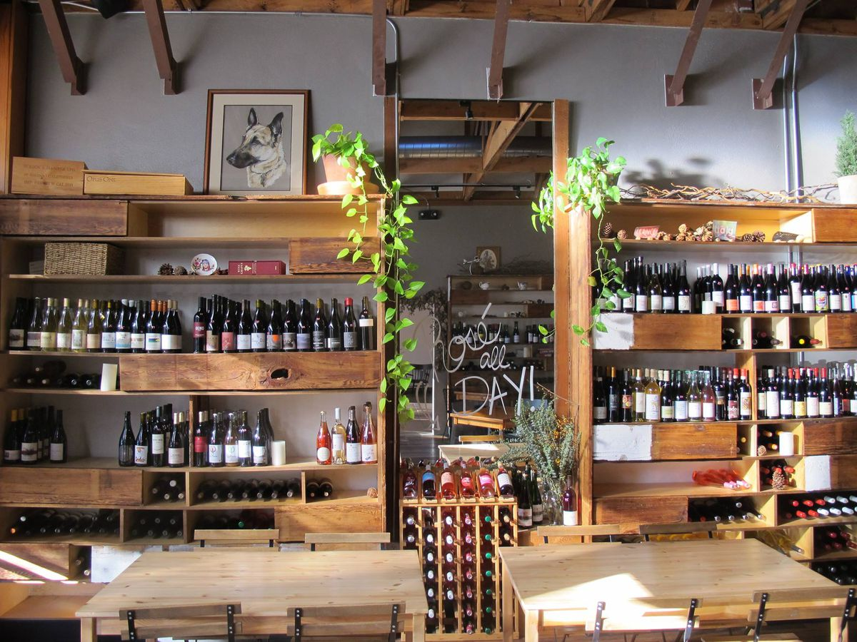 A wall of wine shelves at the Rose.