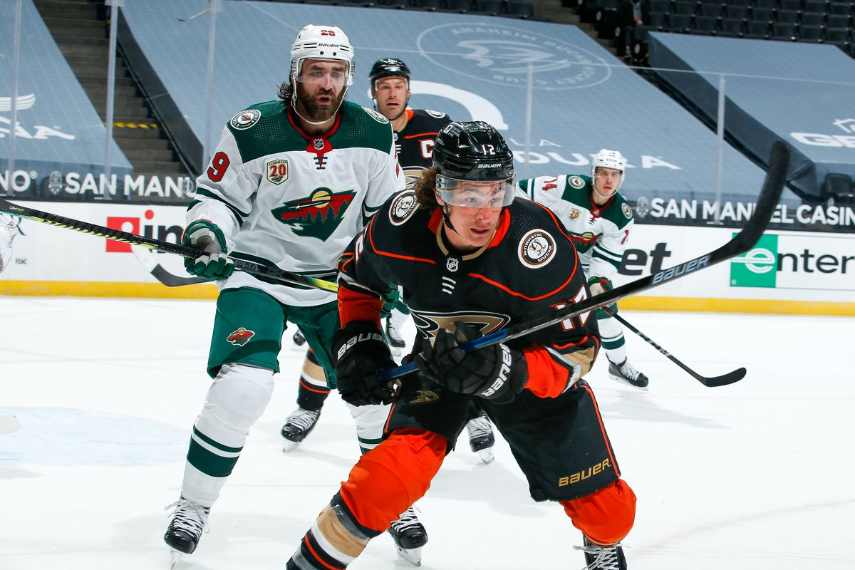 Sonny Milano #12 of the Anaheim Ducks race for the puck as Greg Pateryn #29 and Joel Eriksson Ek #14 of the Minnesota Wild and Ryan Getzlaf #15 of the Anaheim Ducks look on during the second period of the game at Honda Center on January 18, 2021 in Anaheim, California.