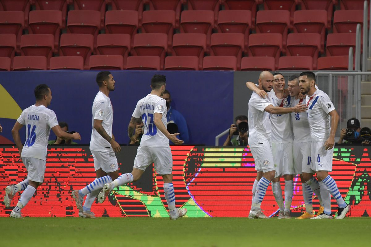 Braian Samudio of Paraguay celebrates with teammates after scoring the first goal of his team during a Group A match between Chile and Paraguay as part of Copa America Brazil 2021 at Mane Garrincha Stadium on June 24, 2021 in Brasilia, Brazil.