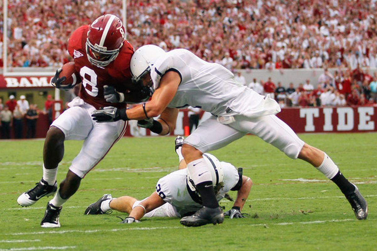 TUSCALOOSA AL - SEPTEMBER 11:  Julio Jones #8 of the Alabama Crimson Tide is tackled by Nick Sukay #1 of the Penn State Nittany Lions at Bryant-Denny Stadium on September 11 2010 in Tuscaloosa Alabama.  (Photo by Kevin C. Cox/Getty Images)