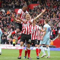 Southampton's Jos Hooiveld (centre) celebrates scoring his sides third goal against Coventry during the Football League Championship match at St Mary's, Southampton, England. Saturday April 28, 2012. Southampton have been promoted to the English Premier League after defeating Coventry 4-0.
