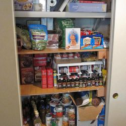 In this photo taken Tuesday, June 28, 2011, extreme coupon cutter Monica Knight shows the stockpile of food she has stored at her home in Boise, Idaho. Knight, a dental hygienist and mother of two, used to spend spent $600 a month on groceries.  Thanks to extreme couponing she's down to $100-150 a month.