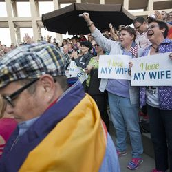 Terri Henry, right, and Penny Kirby, center, cheer during a same sex marriage celebration at Library Square in Salt Lake City, Monday, Oct. 6, 2014.