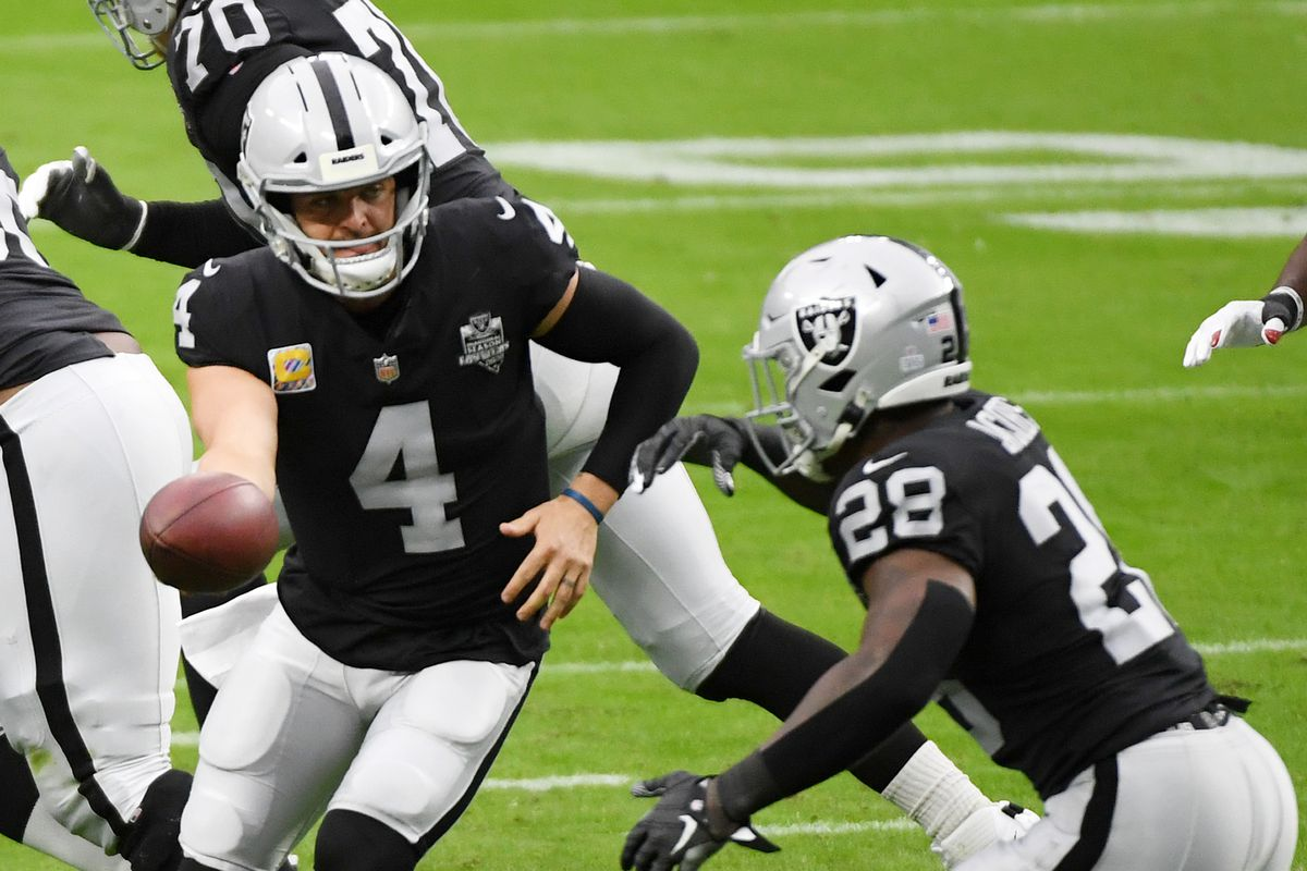 Quarterback Derek Carr #4 of the Las Vegas Raiders hands the ball off to running back Josh Jacobs #28 during the first half of their game against the Tampa Bay Buccaneers at Allegiant Stadium on October 25, 2020 in Las Vegas, Nevada.