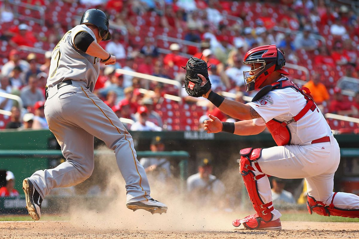 ST. LOUIS, MO - JUNE 30: Alex Presley #7 of the Pittsburgh Pirates scores a run against Tony Cruz #48 of the St. Louis Cardinals at Busch Stadium on June 30, 2012 in St. Louis, Missouri.  (Photo by Dilip Vishwanat/Getty Images)