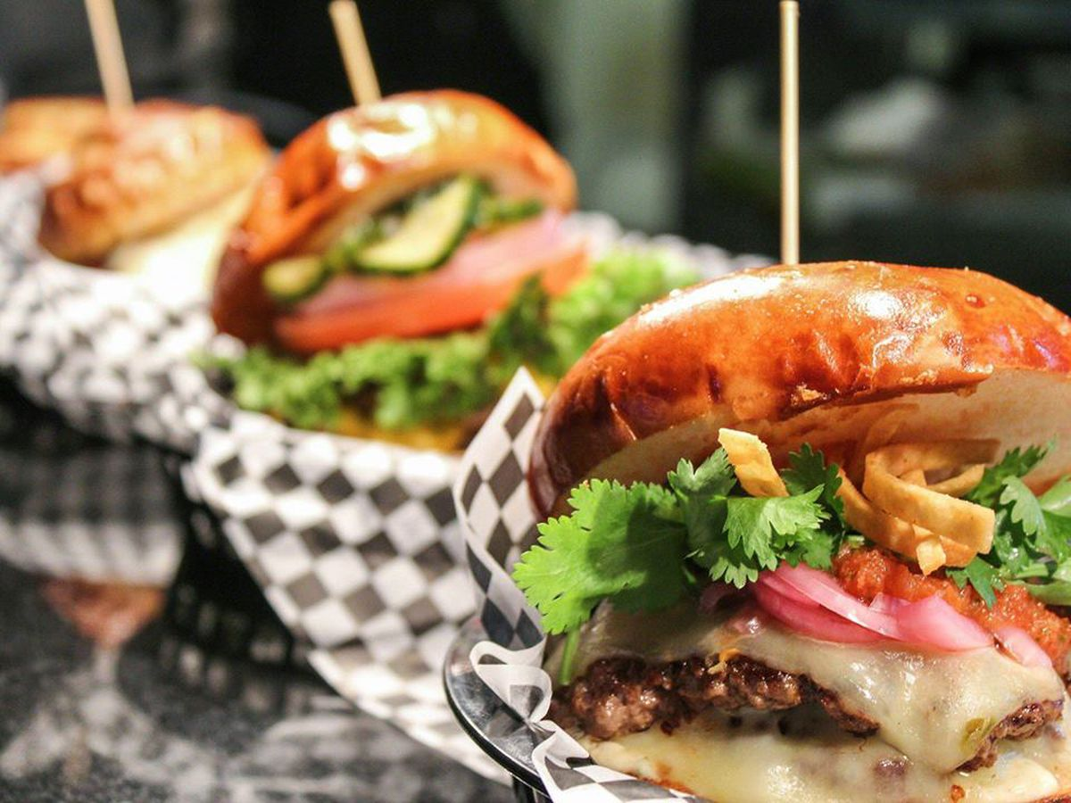 Four burgers in baskets