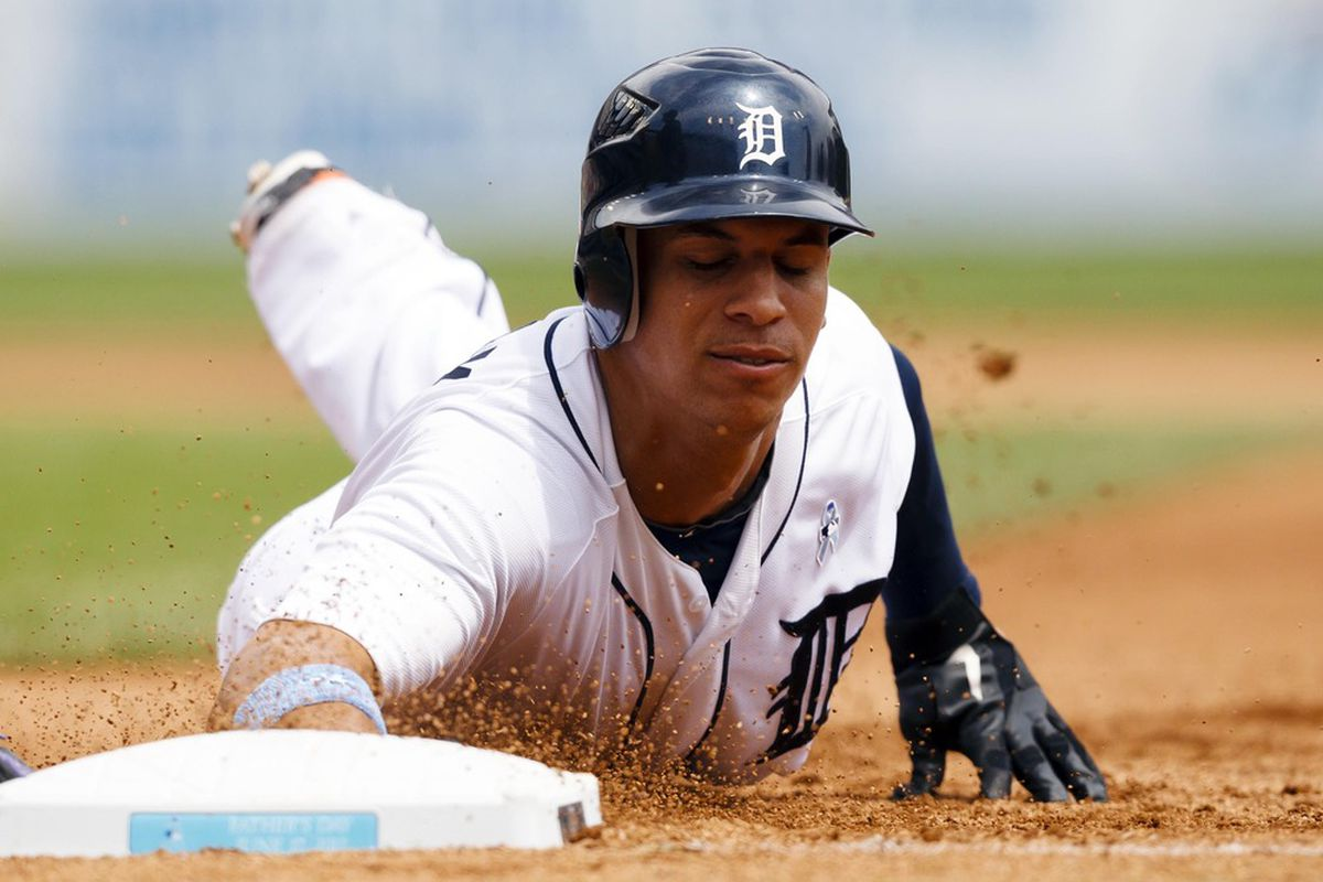 June 17, 2012; Detroit, MI, USA; Detroit Tigers center fielder Quintin Berry (52) dives back to first safely during the fourth inning against the Colorado Rockies at Comerica Park. Mandatory Credit: Rick Osentoski-US PRESSWIRE