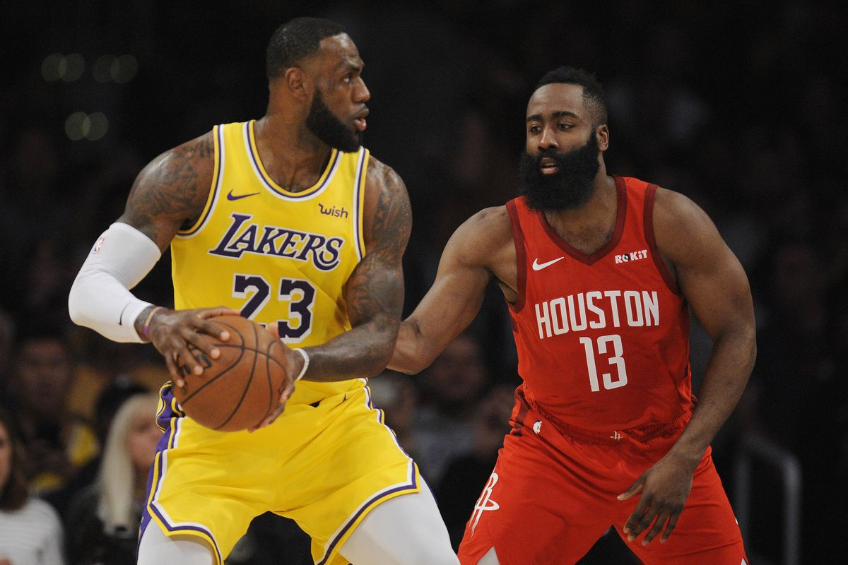 Los Angeles Lakers forward LeBron James controls the ball against Houston Rockets guard James Harden during the first half at Staples Center.