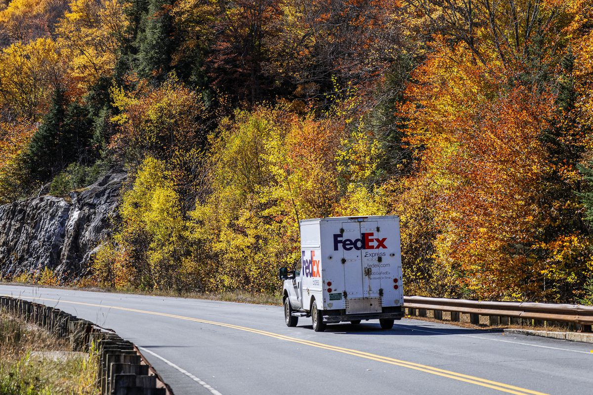 FedEx delivery truck making autumn delivery...