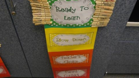 The discipline chart used in Danielle Cole's second-grade classroom at Thimmig. After three warnings, the students land on red and their parents are contacted.