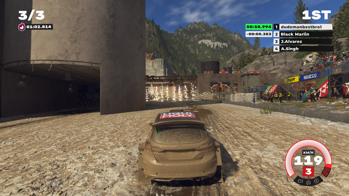 Screenshot of action in Dirt 5, showing a race through an industrial area as sparks shower from an archway