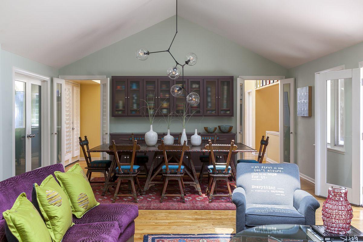 Purple cabinets set against pale-blue walls.