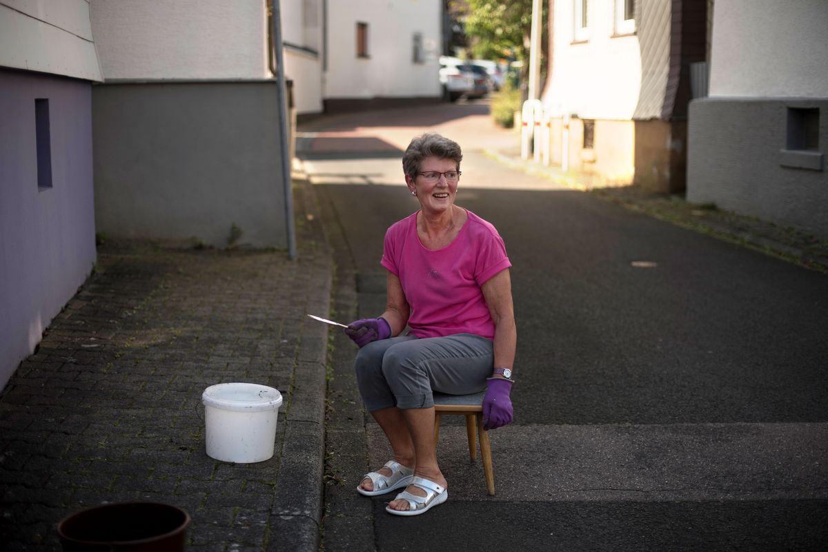 Former postal worker Traudelinde Eichhorn was simply picking weeds from between the bricks in from of her home, when two children from the Al Hammoud family walked into her life. She is pictured here in the spot she was sitting in that moment in front of her home in Neu-Anspach, Germany, on Saturday, Sept. 14, 2019.