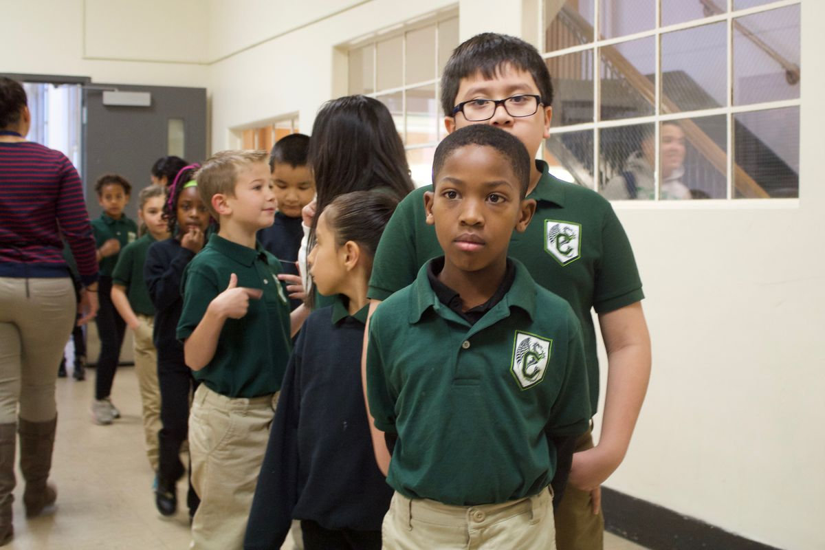 Students line up in the hallway at the Cole Arts and Science Academy in Denver.
