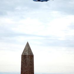 The Space Shuttle Discovery, attached to the back of a Boeing 747 airplane, passes over the Washington Monument, in Washington, Tuesday April 17, 2012.