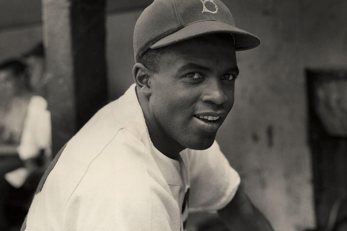 A portrait of the Brooklyn Dodgers' infielder Jackie Robinson in uniform.