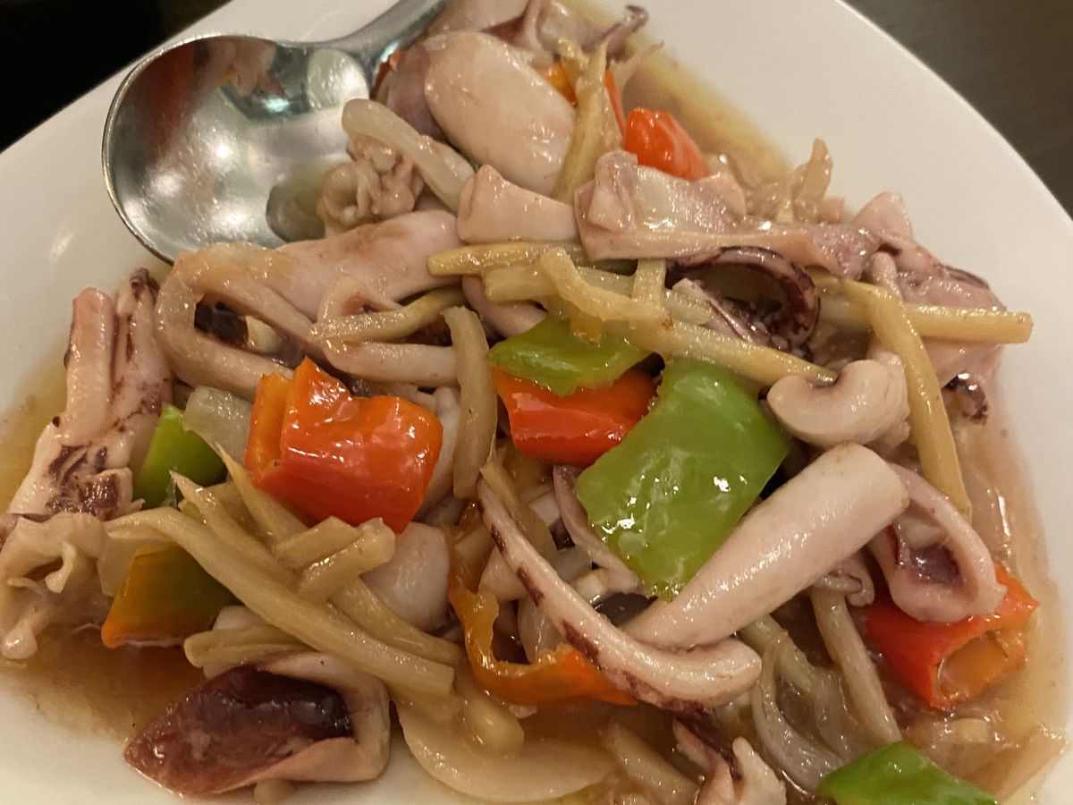 A heart-shaped dish of squid with vegetables in light sauce