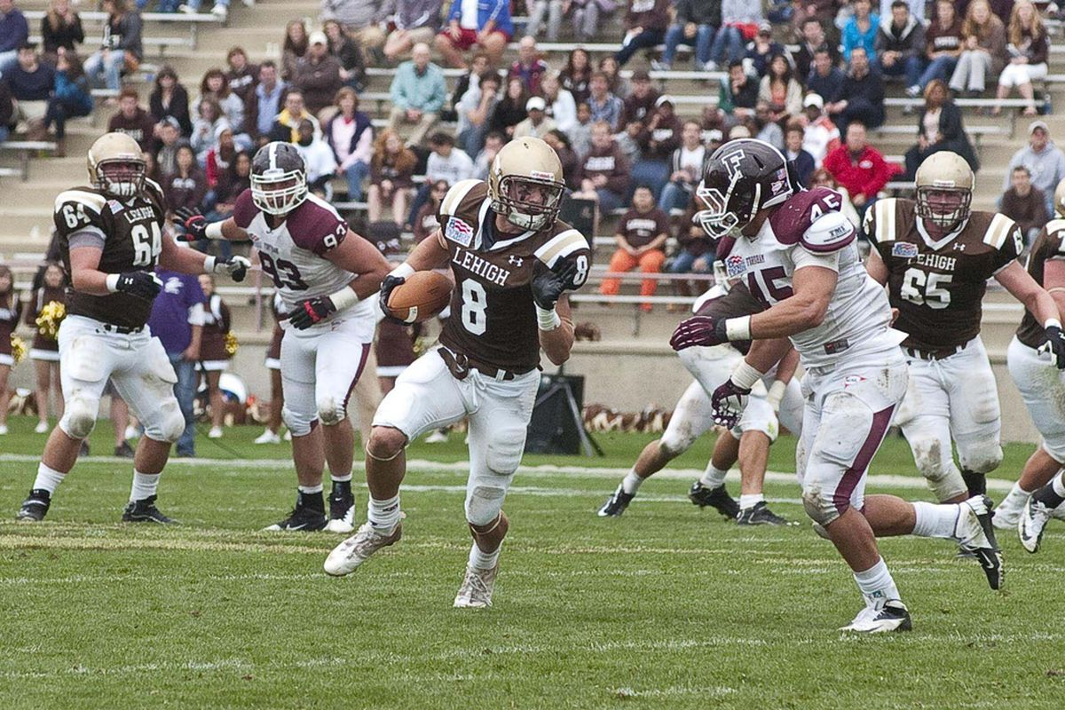 Ryan Spadola (8) runs with the ball after making a catch against Fordham