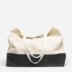Everlane doesn't overcomplicate the beach bag. This simple canvas tote features an interior zip pocket plus a screen-printed, stain-repellent base — so you can throw it on the sand without worrying about getting it dirty.