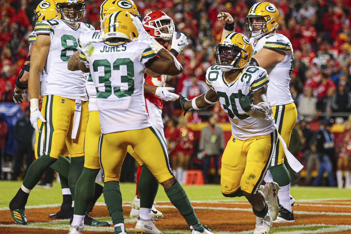 Green Bay Packers running back Jamaal Williams celebrates after scoring a touchdown against the Kansas City Chiefs at Arrowhead Stadium.