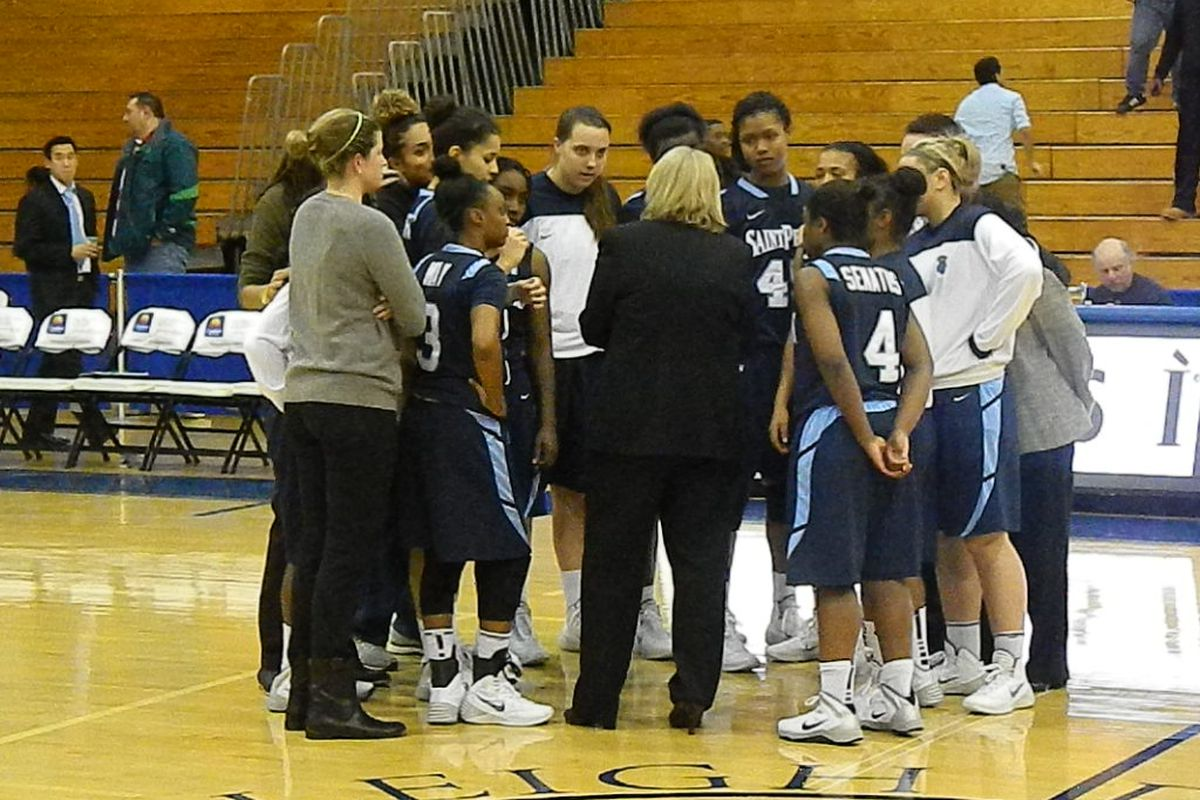 Coach Patty Coyle huddling up with her St. Peter's team.