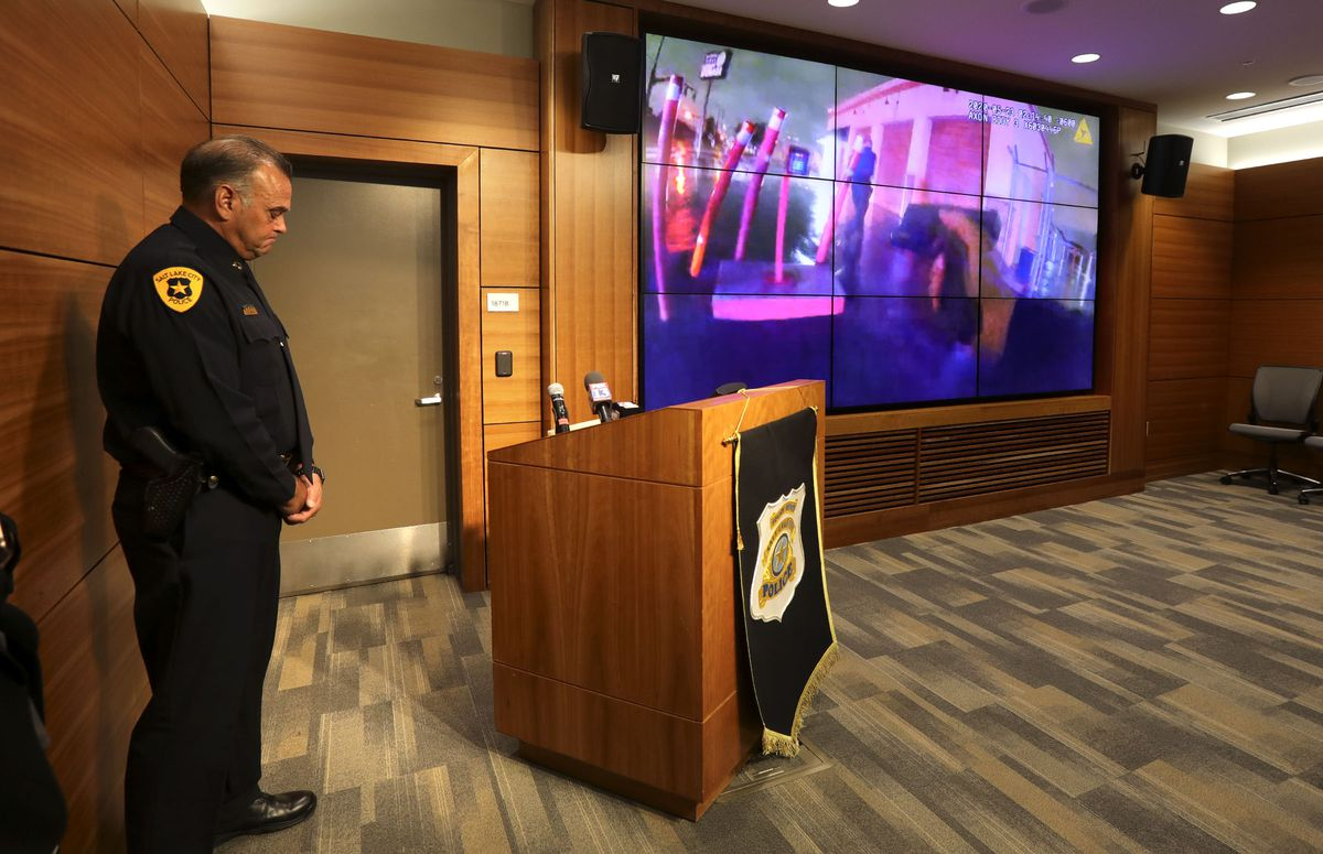 Salt Lake police Capt. Richard Lewis looks down as body cam video from a fatal officer-involved shooting that occurred on May 23 play in the background during a press conference at the Public Safety Building in Salt Lake City on Friday, June 5, 2020.