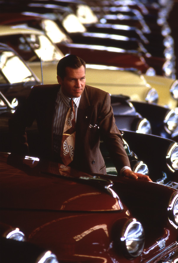 """Preston Tucker (Jeff Bridges) looks over his Chicago factory's output in """"Tucker: A Man and His Dream."""" 
