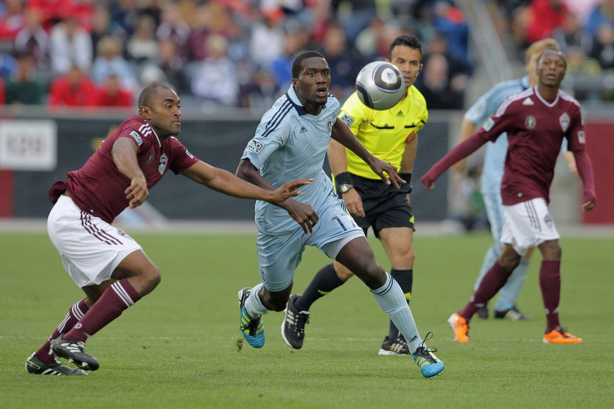 COMMERCE CITY, CO - MAY 28:  Marvell Wynne #22 of the Colorado Rapids and C.J. Sapong #17 of the Sporting KC look to control the ball at Dick's Sporting Goods Park on May 28, 2011 in Commerce City, Colorado.  (Photo by Doug Pensinger/Getty Images)