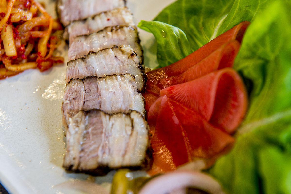 Bossam, spice-braised pork with lettuce wraps.