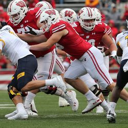 Cormac Sampson (#85) opening a lane. Judging by the number of two TE sets used against Kent State it appears UW coaches are confident in running that formation again. Depth had been an issue until Sampson moved up the chart.