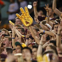 Arizona State fans cheer during the first half of an NCAA college football game against Illinois, Saturday, Sept. 8, 2012,in Tempe, Ariz.