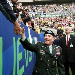 Gen. David Patraeus greets fans before the start of the 2009 NFL Super Bowl football game in Tampa, Fla.