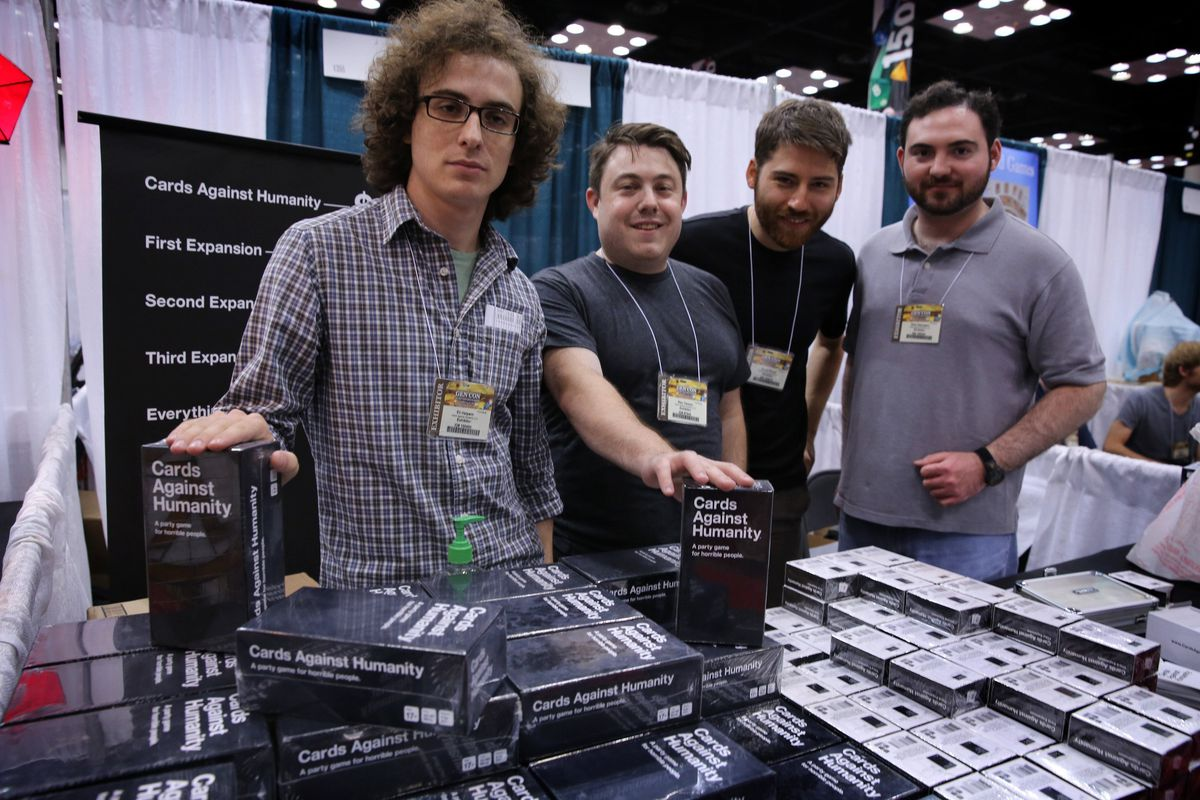 photo of four Cards Against Humanity co-founders at a convention selling the game