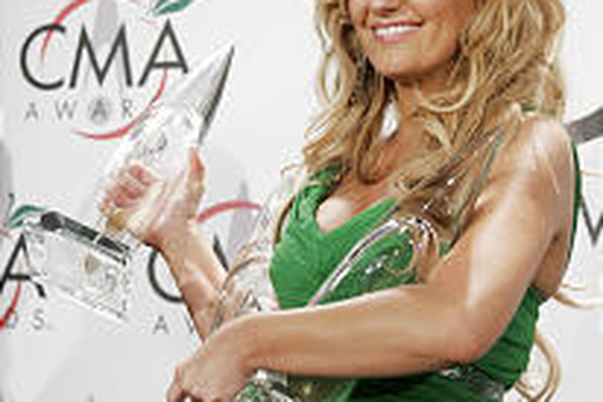Lee Ann Womack won album of the year, single of the year and musical event of the year at the CMA Awards in New York.