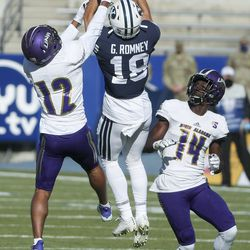 Brigham Young Cougars wide receiver Gunner Romney (18) leaps over North Alabama defensive back K.J. Smith (12) as Romney hauls in a long pass during a game in Provo on Saturday, Nov. 21, 2020.