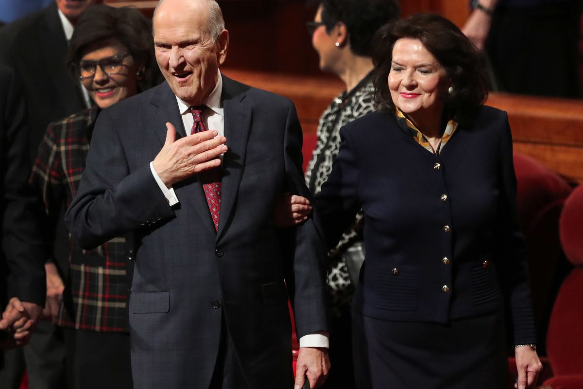 President Russell M. Nelson gestures to attendees along with his wife, Sister Wendy Nelson, after the Sunday afternoon session of the 188th Semiannual General Conference of The Church of Jesus Christ of Latter-day Saints in the Conference Center in downto
