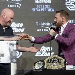 Conor McGregor clinks glasses with Dana White on Thursday at the UFC 229 press conference in New York at Radio City Music Hall.