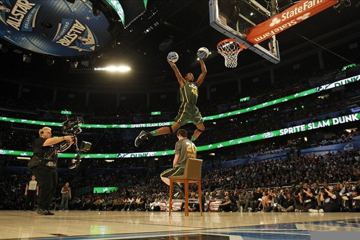Feb 25, 2012; Orlando, FL, USA;  Jeremy Evans of the Utah Jazz completes a double dunk as he jumps over teammate Gordon Hayward (20) in the 2012 NBA All-Star Slam Dunk Contest at the Amway Center. Mandatory Credit: Bob Donnan-US PRESSWIRE