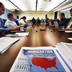 Media, Utah business members and community leaders participate in a roundtable in Cottonwood Heights, Thursday, Nov. 20, 2014, concerning immigration reform.