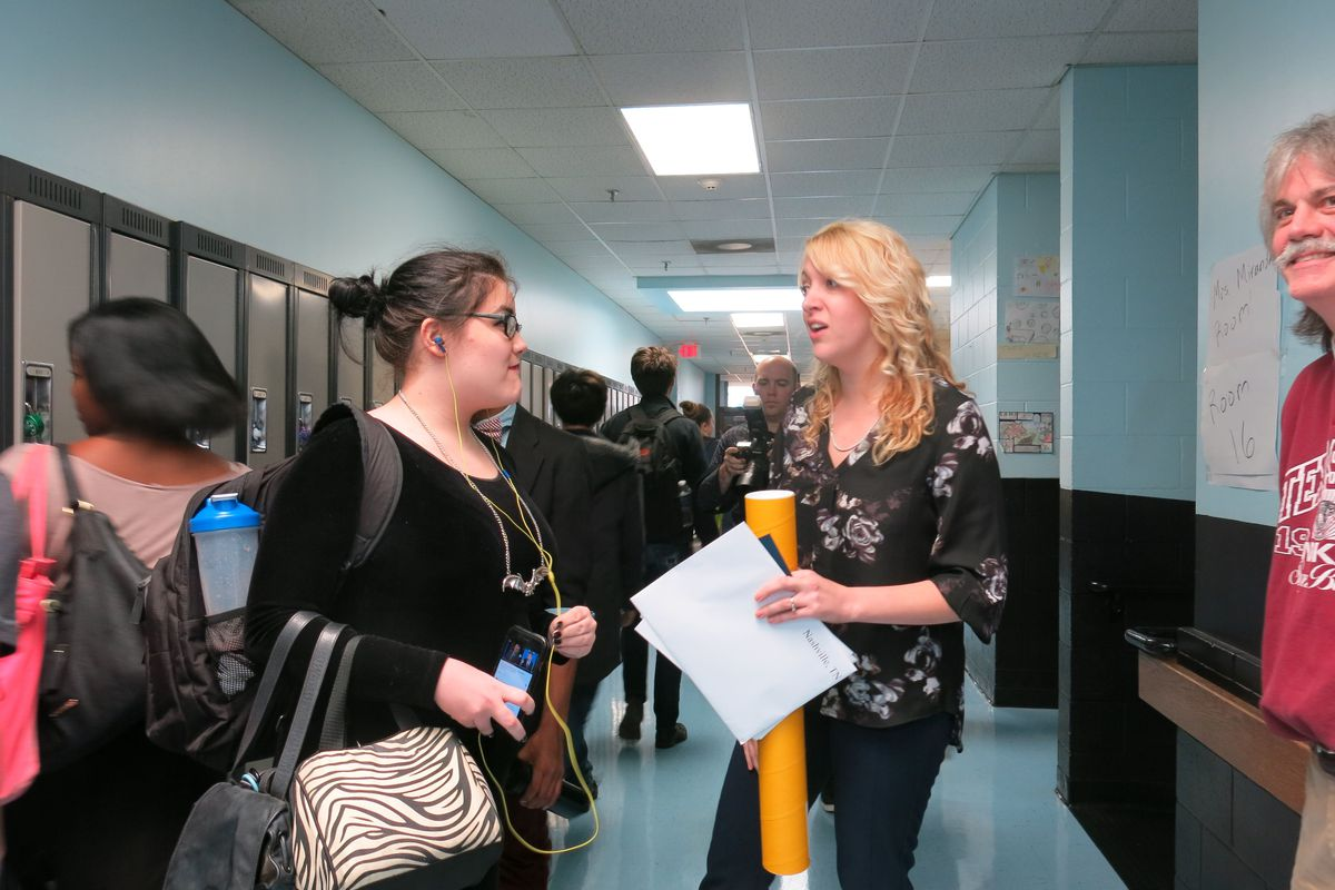 Misty Ayres-Miranda greets a student shortly after being surprised with a $25,000 cash prize.