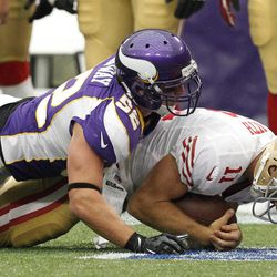 Minnesota Vikings outside linebacker Chad Greenway, left, sacks San Francisco 49ers quarterback Alex Smith during the first half of an NFL football game on Sunday, Sept. 23, 2012, in Minneapolis.