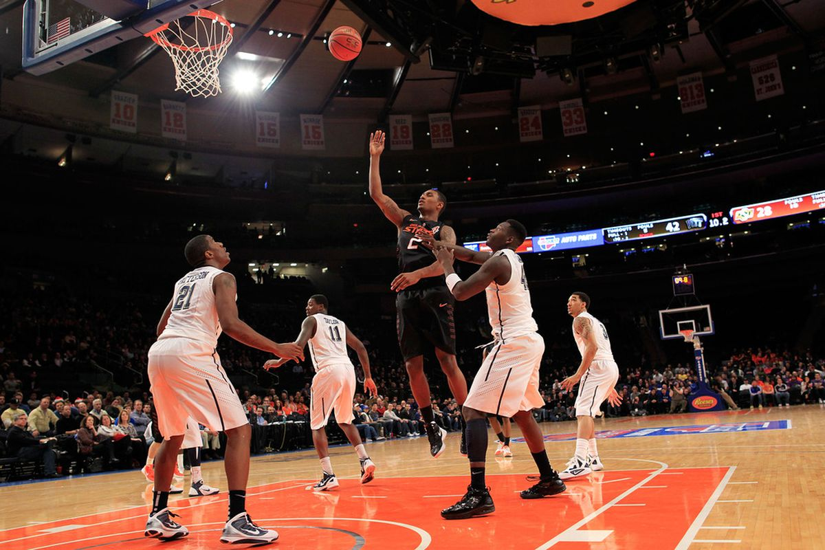 NEW YORK, NY - DECEMBER 10: Le'Bryan Nash #2 of the Oklahoma State Cowboys shoots over Lamar Patterson #21 of the Pittsburgh Panthers at Madison Square Garden on December 10, 2011 in New York City.  (Photo by Chris Trotman/Getty Images)