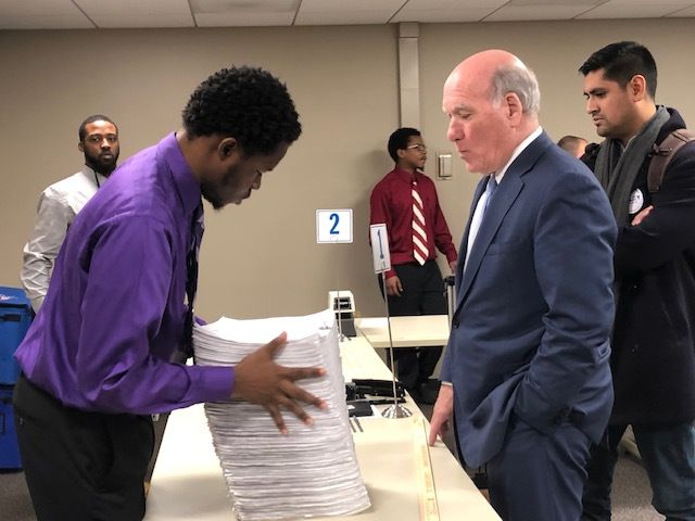 Mayoral candidate Bill Daley (right) files roughly 45,000 signatures Monday on the final day of filing. Daley will join the lottery for last place on the ballot that includes Gery Chico, Garry McCarthy and Dorothy Brown.   Fran Spielman/Sun-Times